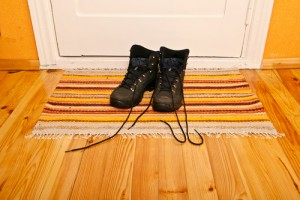 shoes-at-front-door-mat-wood-flooring